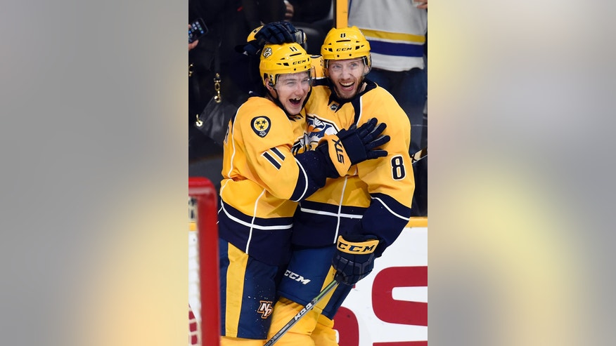 Nashville Predators center Reid Boucher (11) celebrates with defenseman Petter Granberg (8), of Sweden, after Boucher scored a goal against the Minnesota Wild during the second period of an NHL hockey game Tuesday, Dec. 27, 2016, in Nashville, Tenn. (AP Photo/Mark Zaleski)