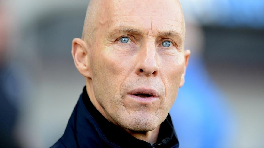 Swansea manager Bob Bradley watches the action during their English Premier League soccer match against West Ham United at the Liberty Stadium, Swansea, Wales, Monday, Dec. 26, 2016. (Simon Galloway/PA via AP)