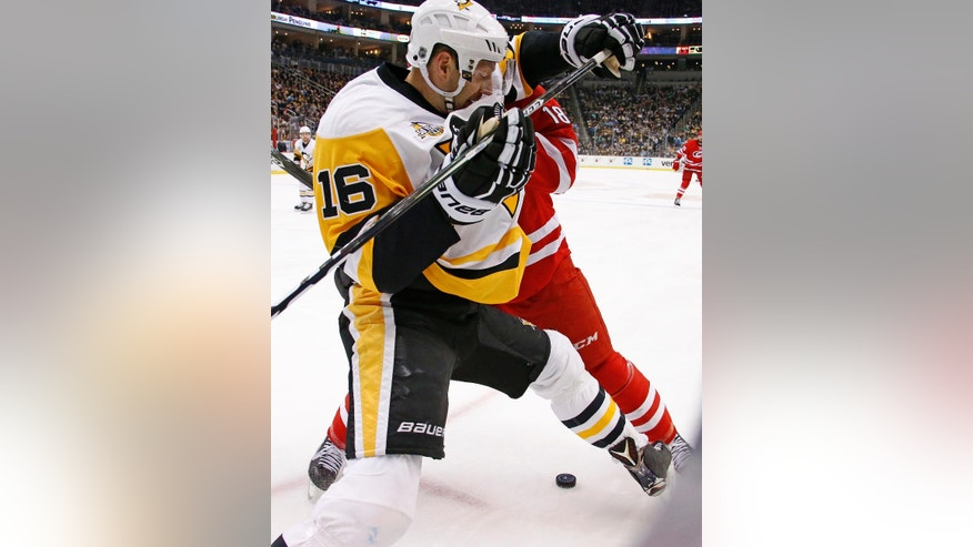 Carolina Hurricanes' Jay McClement (18) checks Pittsburgh Penguins' Eric Fehr (16) off the puck in the second period of an NHL hockey game in Pittsburgh, Wednesday, Dec. 28, 2016. (AP Photo/Gene J. Puskar)