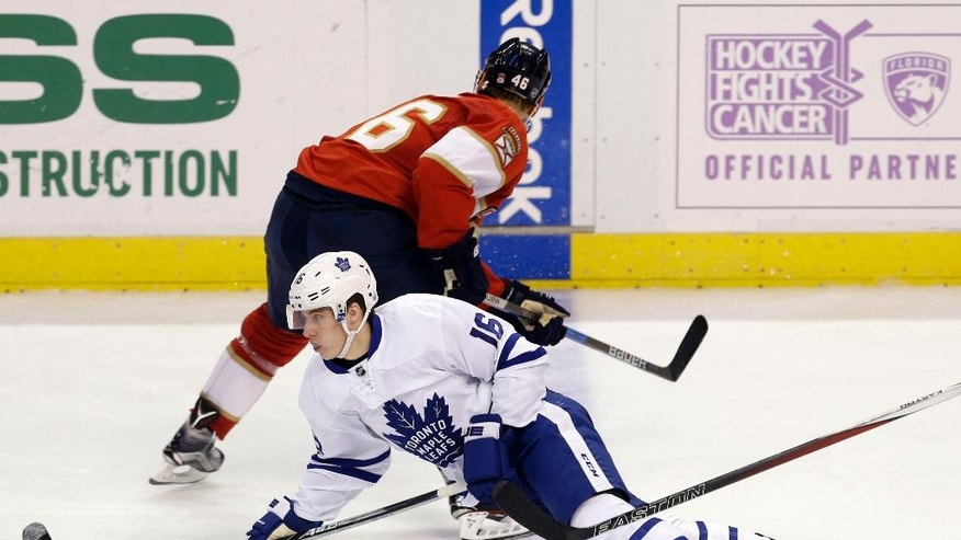 Toronto Maple Leafs center Mitchell Marner (16) falls after colliding with Florida Panthers' Jakub Kindl (46) during the second period of an NHL hockey game, Wednesday, Dec. 28, 2016, in Sunrise, Fla. (AP Photo/Alan Diaz)