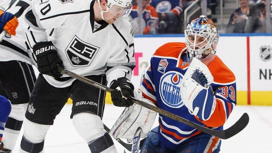 Los Angeles Kings' Tanner Pearson (70) tries to deflect the puck as Edmonton Oilers' goalie Cam Talbot (33) makes the save during the first period of an NHL hockey game in Edmonton, Alberta, Thursday, Dec. 29, 2016. (Jason Franson/The Canadian Press via AP)
