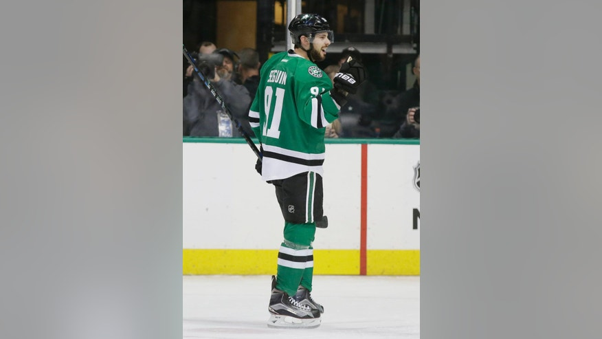 Dallas Stars center Tyler Seguin (91) reacts to scoring a goal during the first period of an NHL hockey game against the Colorado Avalanche in Dallas, Thursday, Dec. 29, 2016. The Stars won 4-2. (AP Photo/LM Otero)