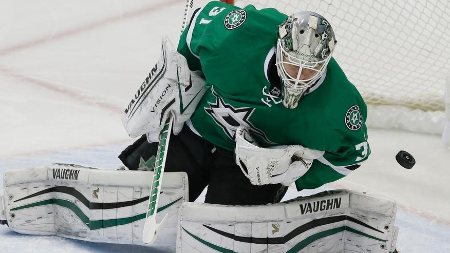 Dallas Stars goalie Antti Niemi (31) blocks a shot on goal during the third period of an NHL hockey game against the Colorado Avalanche in Dallas, Thursday, Dec. 29, 2016. The Stars won 4-2. (AP Photo/LM Otero)