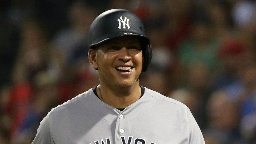 Aug 11, 2016; Boston, MA, USA; New York Yankees designated hitter Alex Rodriguez (13) celebrates after knocking in a run against the Boston Red Sox during the eighth inning at Fenway Park. Mandatory Credit: Mark L. Baer-USA TODAY Sports