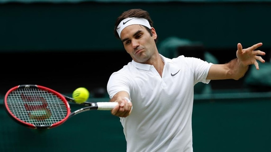 FILE - In this July 8, 2016, file photo, Roger Federer of Switzerland returns to Milos Raonic of Canada during their men's semifinal singles match at the Wimbledon Tennis Championships in London. Federer will return to competitive tennis at the Hopman Cup tournament in Perth, Australia, starting on Jan. 1, 2017.  (AP Photo/Ben Curtis, File)