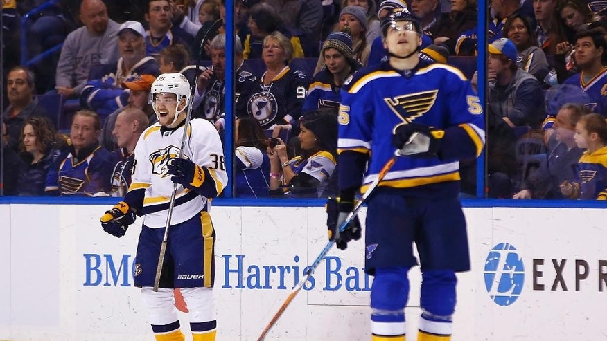Nashville Predators' Viktor Arvidsson, left, of Sweden, smiles after scoring a goal as St. Louis Blues' Colton Parayko skates past during the second period of an NHL hockey game Friday, Dec. 30, 2016, in St. Louis. (AP Photo/Billy Hurst)