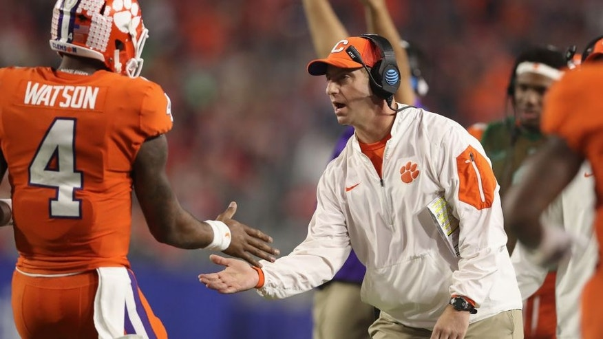 GLENDALE, AZ - DECEMBER 31: Head coach Dabo Swinney of the Clemson Tigers and Deshaun Watson #4 react after a first quarter touchdown during the 2016 PlayStation Fiesta Bowl against the Ohio State Buckeyes at University of Phoenix Stadium on December 31, 2016 in Glendale, Arizona. (Photo by Christian Petersen/Getty Images)
