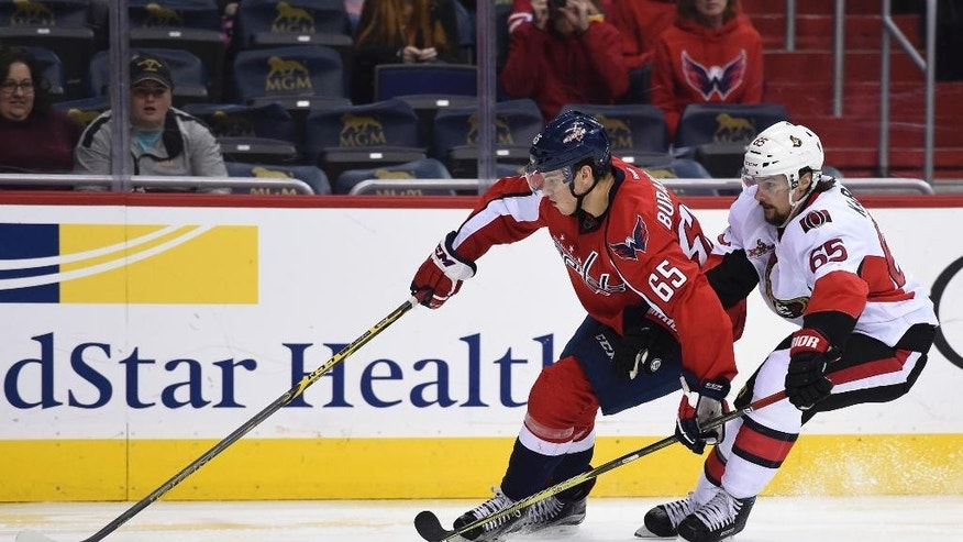 Ottawa Senators' Erik Karlsson (65) pressures Washington Capitals left wing Andre Burakovsky (65), of Austria, during the second period of an NHL hockey game, Sunday, Jan. 1, 2017, in Washington. (AP Photo/Molly Riley)