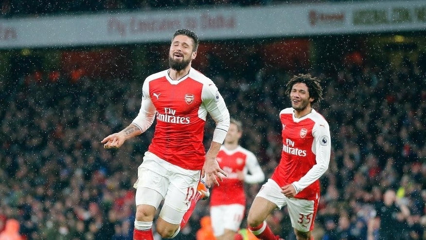 Arsenal's Olivier Giroud celebrates after scoring during the English Premier League soccer match between Arsenal and Crystal Palace at the Emirates stadium in London, Sunday, Jan. 1, 2017.(AP Photo/Frank Augstein)