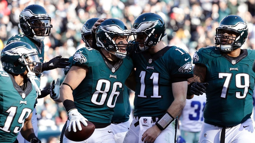 Philadelphia Eagles' Zach Ertz, #86, celebrates his touchdown catch with Carson Wentz during the first half of an NFL football game, Sunday, Jan. 1, 2017, in Philadelphia.