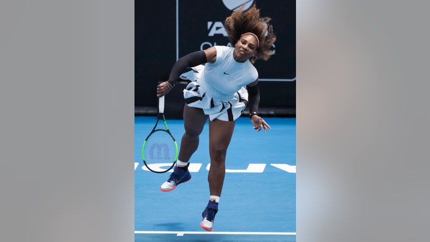 United States' Serena Williams serves during her first round match against Pauline Parmentier of France at the ASB Classic tennis tournament in Auckland, New Zealand, Tuesday, Jan. 3, 2017. Williams won in straight sets 6-3, 6-4. (Jason Oxenham/New Zealand Herald via AP)