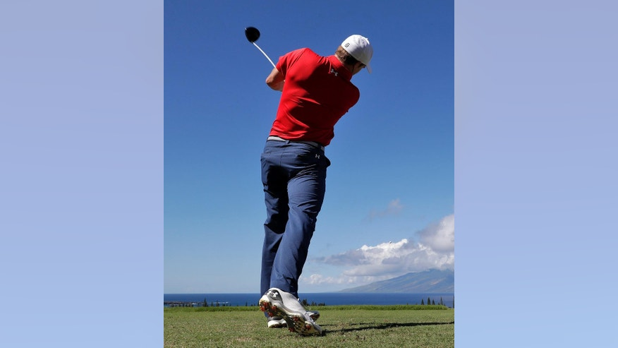 Jordan Spieth hits from the first tee during the pro-am tournament prior to the Tournament of Champions golf event, Wednesday, Jan. 4, 2017, at Kapalua Plantation Course in Kapalua, Hawaii. (AP Photo/Matt York)