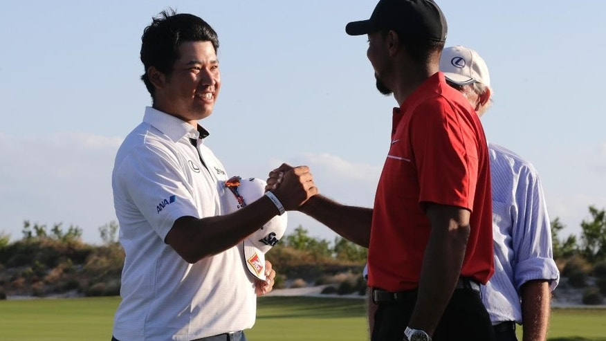 In this Sunday, Dec. 4, 2016, photo, Hideki Matsuyama, of Japan, left, shakes hands with Tiger Woods after winning the Hero World Challenge golf tournament in Nassau, Bahamas. Matsuyama starts a new year at the SBS Tournament of Champions as the hottest player in golf with three straight victories. (AP Photo/Lynne Sladky)