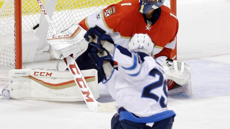 Winnipeg Jets right wing Patrik Laine (29) scores a goal against Florida Panthers goalie Roberto Luongo (1) during the second period of an NHL hockey game, Wednesday, Jan. 4, 2017, in Sunrise, Fla. (AP Photo/Alan Diaz)