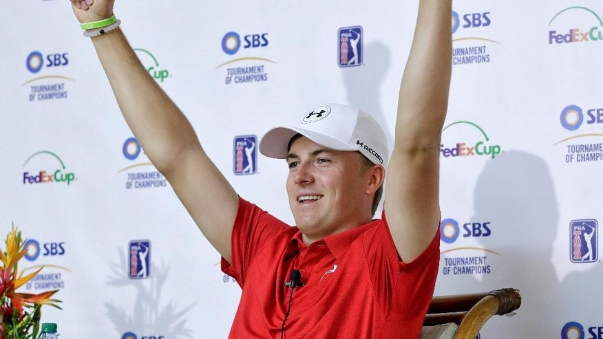 Defending champion Jordan Spieth raises his arms while speaking at a news conference at the Tournament of Champions golf tournament, Wednesday, Jan. 4, 2017, at Kapalua Plantation Course in Kapalua, Hawaii. (AP Photo/Matt York)