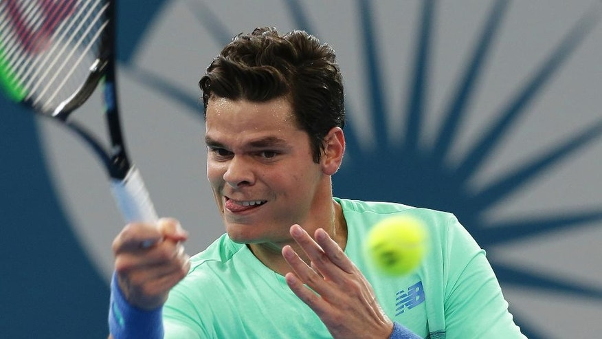 Milos Raonic of Canada plays a shot during his match against Diego Schwartzman of Argentina at the Brisbane International tennis tournament in Brisbane, Australia, Thursday, Jan. 5, 2017. (AP Photo/Tertius Pickard)