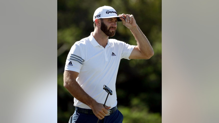 Dustin Johnson tips his cap on the 18th green during the pro-am at the Tournament of Champions golf event, Wednesday, Jan. 4, 2017, at Kapalua Plantation Course in Kapalua, Hawaii. (AP Photo/Matt York)