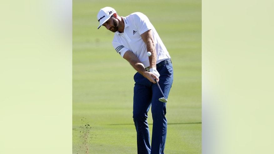 Dustin Johnson hits onto the 18th green during the pro-am at the Tournament of Champions golf event, Wednesday, Jan. 4, 2017, at Kapalua Plantation Course in Kapalua, Hawaii. (AP Photo/Matt York)