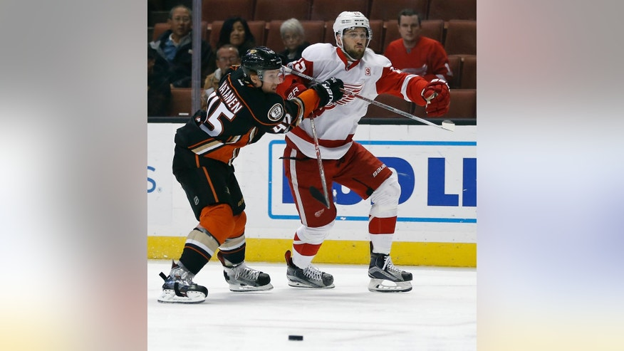 Anaheim Ducks defenseman Sami Vatanen (45), of Finland, stops Detroit Red Wings center Riley Sheahan (15) from the puck during the first period of an NHL hockey game in Anaheim, Calif., Wednesday, Jan. 4, 2017. (AP Photo/Alex Gallardo)