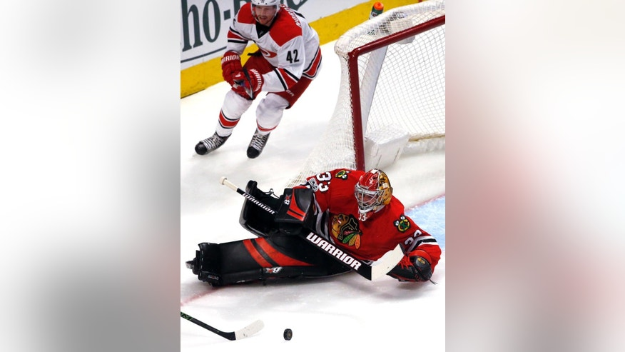 Chicago Blackhawks goalie Scott Darling blocks a shot by Carolina Hurricanes center Jordan Staal during the second period of an NHL hockey game Friday, Jan. 6, 2017, in Chicago. (AP Photo/Nam Y. Huh)