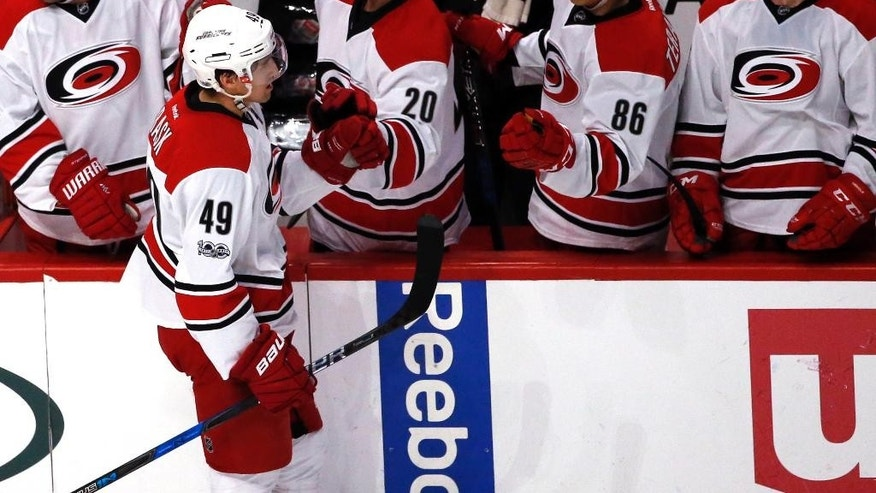 Carolina Hurricanes center Victor Rask (49) celebrates with teammates after scoring a goal against the Chicago Blackhawks during the second period of an NHL hockey game Friday, Jan. 6, 2017, in Chicago. (AP Photo/Nam Y. Huh)