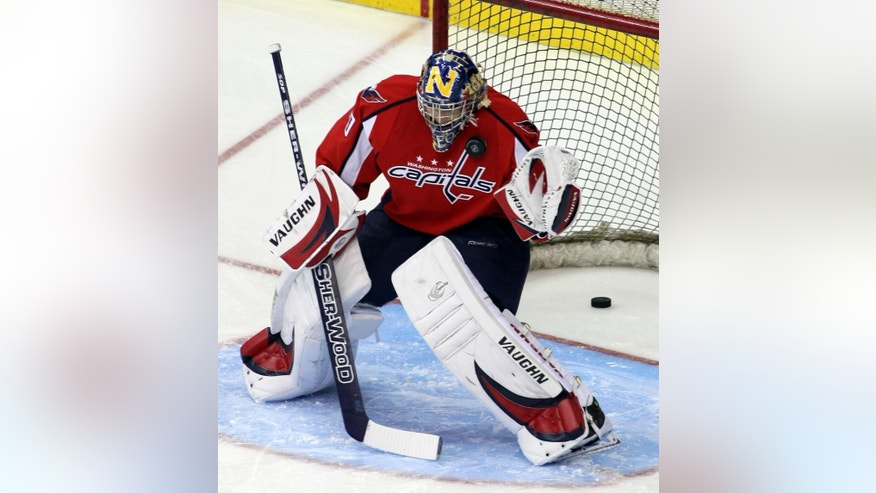 FILE - In this Dec. 12, 2008, file photo, Washington Capitals backup goaltender Brett Leonhardt warms-up before an NHL hockey game against Ottawa Senators, in Washington. Hockey is the only professional sport where someone can go from being a fan to suiting up in the NHL. Injuries and illnesses to goaltenders have opened the door for anyone from equipment managers to Zamboni drivers and amateur coaches to dress or even play goal in an NHL game. (AP Photo/Luis M. Alvarez, File)