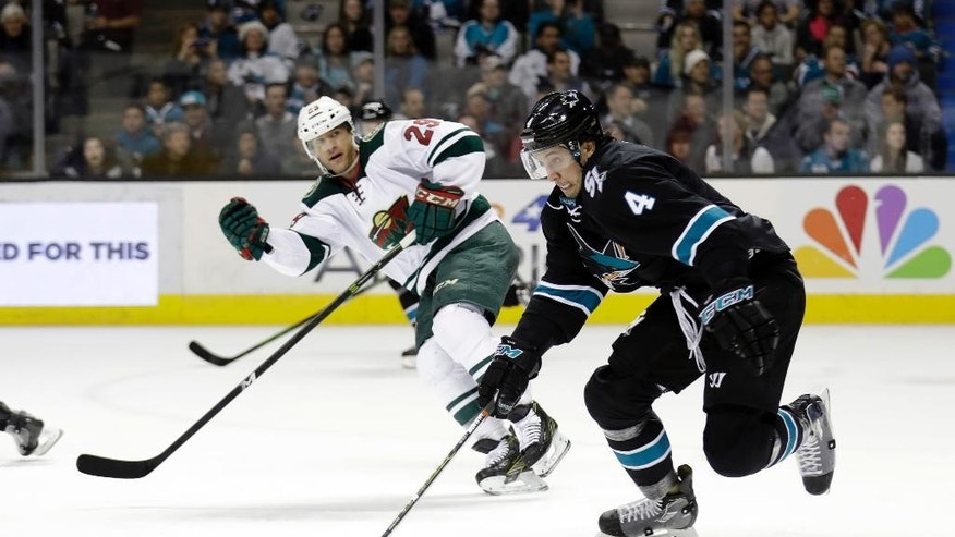 San Jose Sharks' Brenden Dillon (4) skates next to Minnesota Wild's Jason Pominville (29) during the second period of an NHL hockey game Thursday, Jan. 5, 2017, in San Jose, Calif. (AP Photo/Marcio Jose Sanchez)
