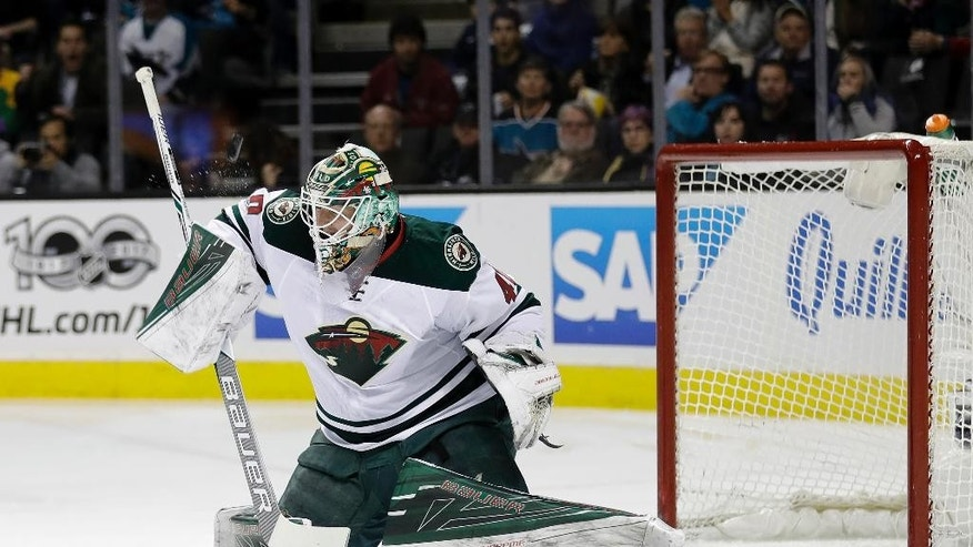 Minnesota Wild goalie Devan Dubnyk stops a shot during the first period of an NHL hockey game against the San Jose Sharks, Thursday, Jan. 5, 2017, in San Jose, Calif. (AP Photo/Marcio Jose Sanchez)