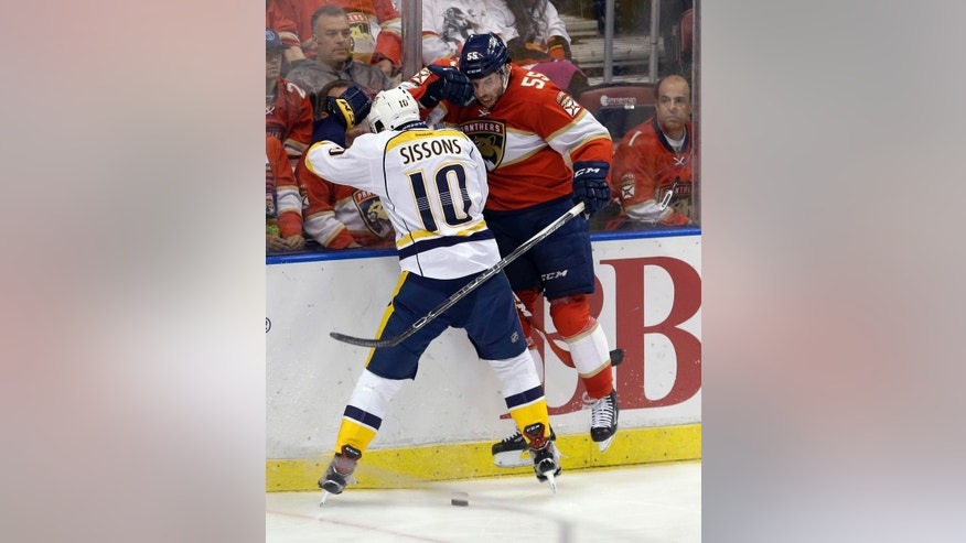 Florida Panthers defenseman Jason Demers (55) is checked by Nashville Predators center Colton Sissons (10) during the second period of an NHL hockey game, Friday, Jan. 6, 2017, in Sunrise, Fla. (AP Photo/Alan Diaz)