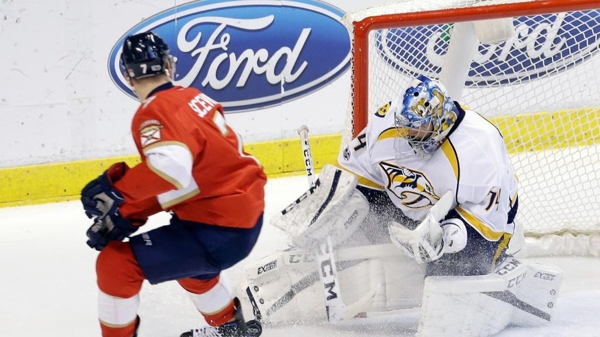 Nashville Predators goalie Juuse Saros (74) stops a shot by Florida Panthers center Colton Sceviour (7) during the first period of an NHL hockey game, Friday, Jan. 6, 2017, in Sunrise, Fla. (AP Photo/Alan Diaz)