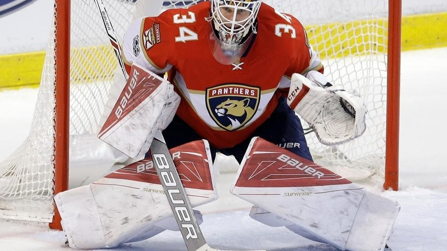 Florida Panthers goalie James Reimer (34) prepares to stop a shot during the second period of an NHL hockey game against the Nashville Predators, Friday, Jan. 6, 2017, in Sunrise, Fla. (AP Photo/Alan Diaz)