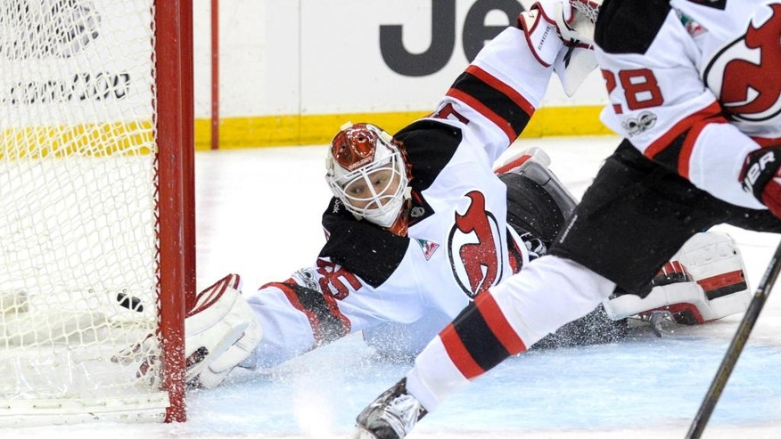 New Jersey Devils goaltender Cory Schneider cannot stop a shot by the Toronto Maple Leafs which goes into the net for a goal during the first period of an NHL hockey game Friday, Jan. 6, 2017, in Newark, N.J. (AP Photo/Bill Kostroun)