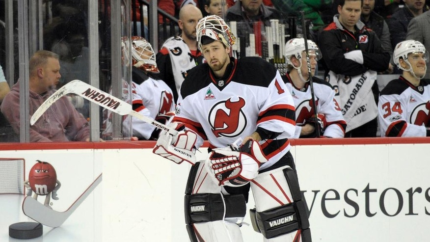 New Jersey Devils goaltender Keith Kinkaid skates onto the ice to replace Cory Schneider, left, after the Toronto Maple Leafs scored three goals during the first period of an NHL hockey game Friday, Jan. 6, 2017, in Newark, N.J. (AP Photo/Bill Kostroun)