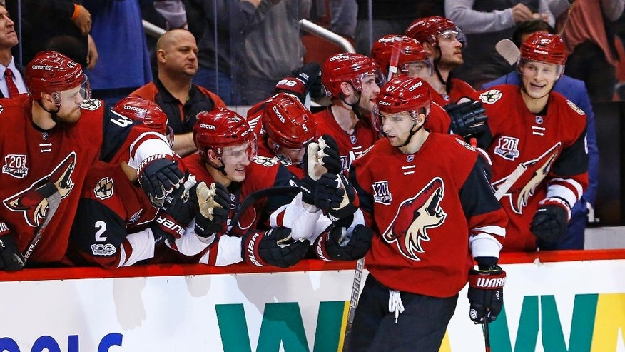 Arizona Coyotes right wing Radim Vrbata, front right, celebrates his game-winning goal against the New York Islanders during the shootout of an NHL hockey game Saturday, Jan. 7, 2017, in Glendale, Ariz. The Coyotes defeated the Islanders 2-1. (AP Photo/Ross D. Franklin)