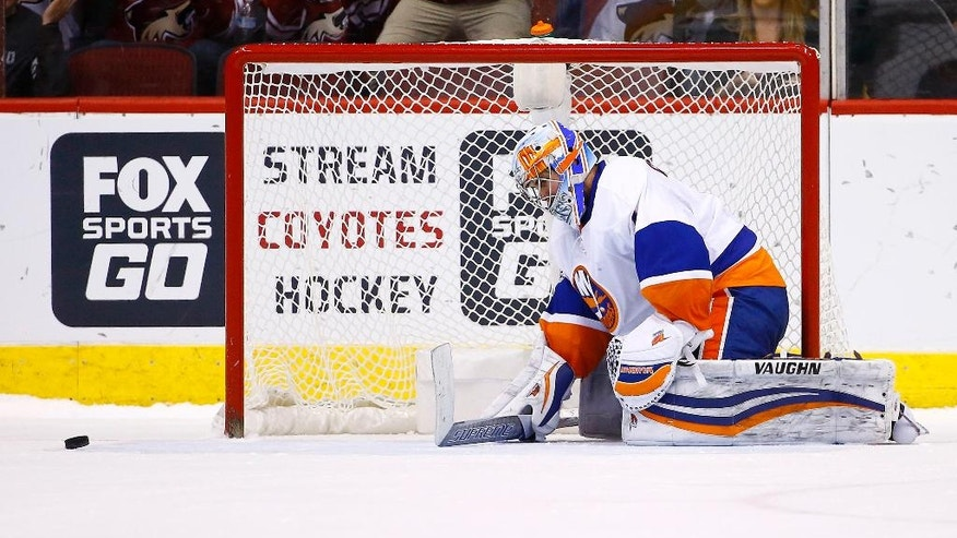 New York Islanders goalie Thomas Greiss pauses on the ice after giving up the game-winning goal to Arizona Coyotes right wing Radim Vrbata during the shootout of an NHL hockey game Saturday, Jan. 7, 2017, in Glendale, Ariz. The Coyotes defeated the Islanders 2-1. (AP Photo/Ross D. Franklin)