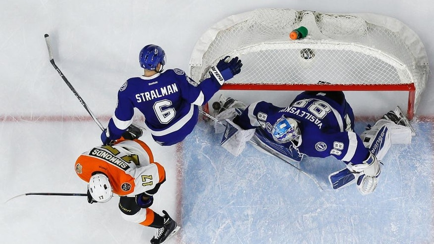 Tampa Bay Lightning's Andrei Vasilevskiy (88) cannot block a goal by Philadelphia Flyers' Radko Gudas past Tampa's Anton Stralman (6) and Flyers' Wayne Simmonds (17) during the second period of an NHL hockey game, Saturday, Jan. 7, 2017, in Philadelphia. (AP Photo/Matt Slocum)