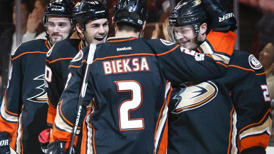 Anaheim Ducks' Chris Wagner, right, is congratulated by teammates Kevin Bieksa (2) and Jared Boll (40) after scoring a goal in the second period of an NHL hockey game against the Arizona Coyotes in Anaheim, Calif., Friday, Jan. 6, 2017. (AP Photo/Christine Cotter)