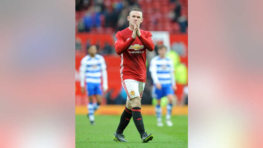 Manchester United's Wayne Rooney applauds the fans as he walks from the pitch after the end of the English FA Cup Third Round match between Manchester United and Reading at Old Trafford in Manchester, England, Saturday, Jan. 7, 2017. United won the match 4-0. (AP Photo/Rui Vieira)