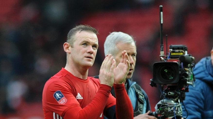 Manchester United's Wayne Rooney applauds the fans after the end of the the English FA Cup Third Round match between Manchester United and Reading at Old Trafford in Manchester, England, Saturday, Jan. 7, 2017. United won the game 4-0. (AP Photo/Rui Vieira)