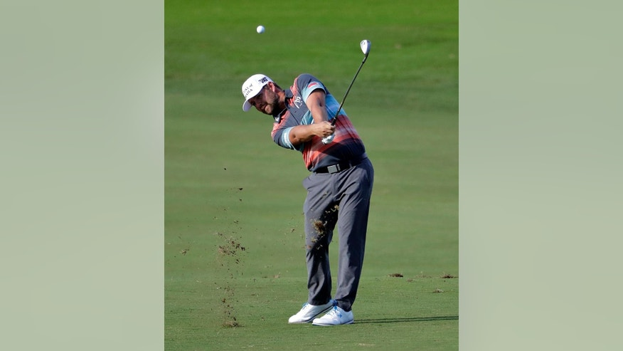 Ryan Moore hits from the 10th fairway during the second round of the Tournament of Champions golf event, Friday, Jan. 6, 2017, at Kapalua Plantation Course in Kapalua, Hawaii. (AP Photo/Matt York)