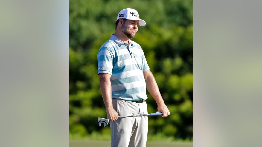 Ryan Moore reacts to missing his birdie putt on the 17th green during the first round of the Tournament of Champions golf event, Thursday, Jan. 5, 2017, at Kapalua Plantation Course in Kapalua, Hawaii. (AP Photo/Matt York)