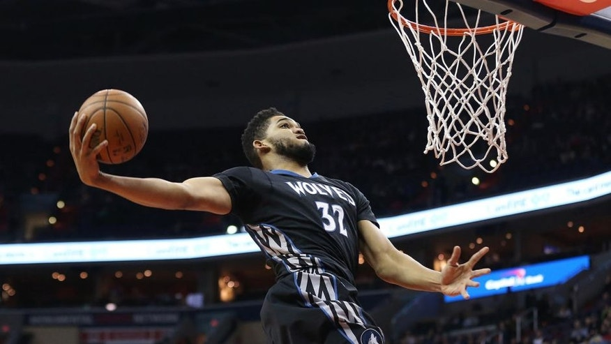 Jan 6, 2017; Washington, DC, USA; Minnesota Timberwolves center Karl-Anthony Towns (32) dunks the ball against the Washington Wizards in the first quarter at Verizon Center. Mandatory Credit: Geoff Burke-USA TODAY Sports