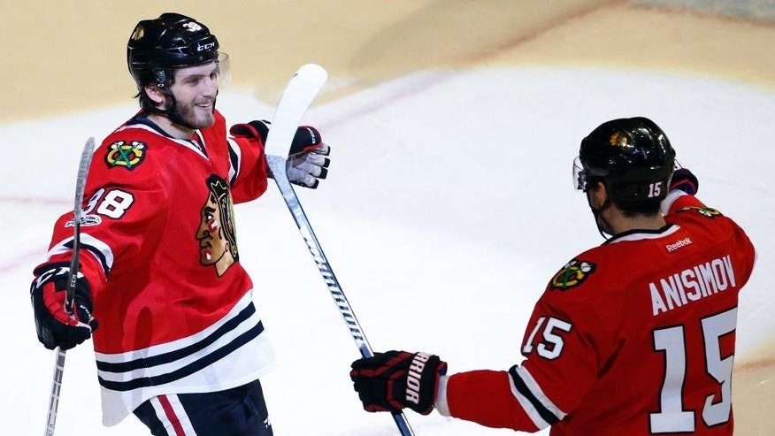 Chicago Blackhawks right wing Ryan Hartman, left, celebrates with center Artem Anisimov after scoring his third goal against the Nashville Predators during the third period of an NHL hockey game Sunday, Jan. 8, 2017, in Chicago. The Blackhawks won 5-2. (AP Photo/Nam Y. Huh)