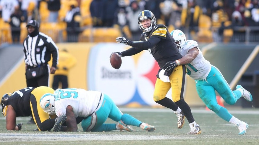 Jan 8, 2017; Pittsburgh, PA, USA; Pittsburgh Steelers quarterback Ben Roethlisberger (7) attempts to throw the ball as Miami Dolphins defensive end Cameron Wake (91) tackles during the second half in the AFC Wild Card playoff football game at Heinz Field. Mandatory Credit: Charles LeClaire-USA TODAY Sports