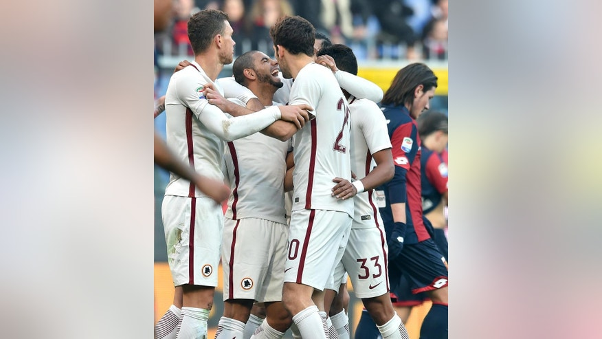 Roma's Brazilian defender Bruno Peres, second from left, celebrates with his teammates Bosnian forward Edin Dzeko, Argentinian defender Federico Fazio and Brazilian defender Emerson Palmieri, after Genoa's Italian defender Armando Izzo scored an own goal during a Serie A soccer match between Genoa and Roma at Genoa's Luigi Ferraris Stadium, Italy, Jan. 8, 2017.  (Simone Arveda/ANSA via AP)