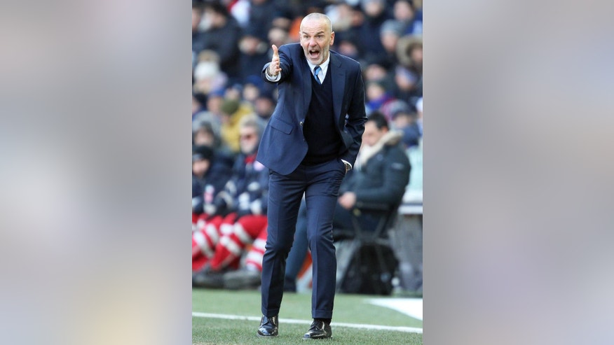 Inter Milan's head coach Stefano Pioli gives directions to his players during a Serie A soccer match between Udinese and Inter Milan, at Friuli stadium in Udine, Italy, Sunday, Jan. 8, 2017. (Alberto Lancia/ANSA via AP)