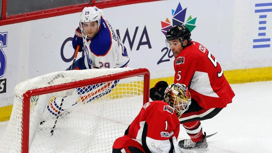 Ottawa Senators defenseman Cody Ceci (5) reacts as Edmonton Oilers center Leon Draisaitl (29) scores on goalie Mike Condon (1) during the second period of an NHL hockey game in Ottawa on Sunday, Jan. 8, 2017. (Fred Chartrand/The Canadian Press via AP)