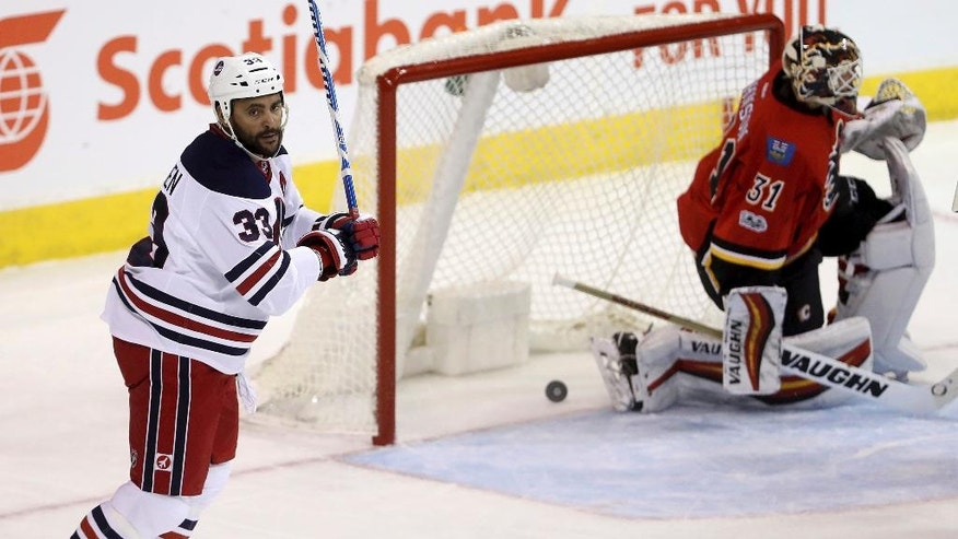 Winnipeg Jets defenseman Dustin Byfuglien (33) scores against the Calgary Flames during the first period of an NHL Hockey game Monday, Jan. 9, 2017, in Winnipeg, Manitoba. (Trevor Hagan/The Canadian Press via AP)