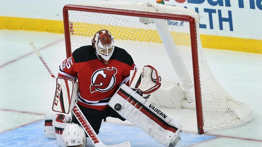 New Jersey Devils goalie Cory Schneider (35) blocks a shot by Florida Panthers right wing Reilly Smith (18) during the second period of an NHL hockey game Monday, Jan. 9, 2017, in Newark, N.J. (AP Photo/Mel Evans)