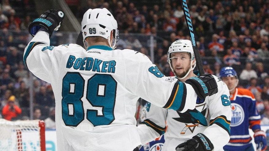 San Jose Sharks' Mikkel Boedker (89) and Melker Karlsson (68) celebrate a goal against the Edmonton Oilers during the first period of an NHL hockey game, Tuesday, Jan. 10, 2017 in Edmonton, Alberta.  (Jason Franson/The Canadian Press via AP)